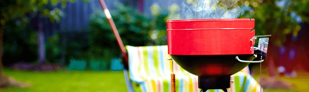 Backyard Party with a red grill.